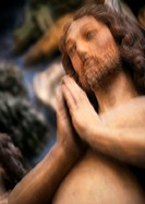 Statue of Christ, low angle view, blurred
