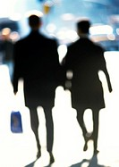 Silhouettes of women in street, blurred