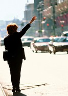 Woman in street, raising arm