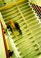 Man on stairs, high angle view, blurred