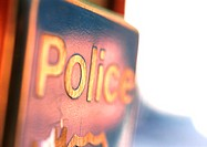 'Police' text on sign, close-up