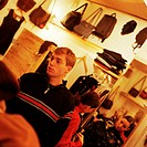 Young people in clothing store