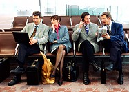 Group of business people sitting in terminal