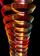 Spiraling light effect, one within the other, reds, yellows and hints of blues