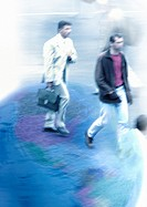 Businessmen walking on globe, montage
