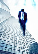 Businessman walking on side of skyscraper, montage