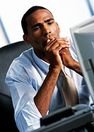 Businessman looking at computer (thumbnail)