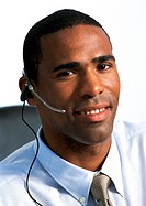 Man wearing headset, close-up, portrait