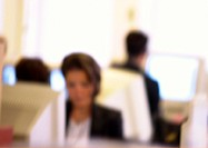 People working at computers in office, blurred