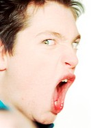 Teenage boy shouting, close-up, portrait