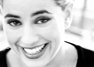 Woman smiling, close-up, blurred, b&w