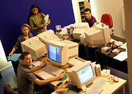 Four people in office, high angle view, portrait
