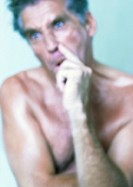 Topless mature man making face, close-up, portrait, blurred