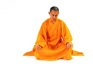 Buddhist monk meditating in lotus position