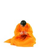 Buddhist monk meditating, holding scroll