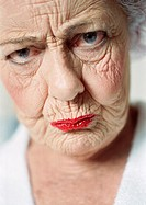 Elderly woman frowning, portrait, close-up