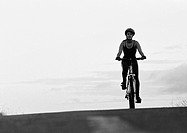 Woman cycling, b&w