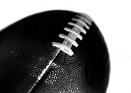 Football, close-up, b&w