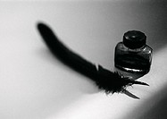 Quill pen and bottle of ink, b&w