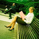 Two business people sitting on benches