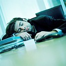 Young businessman sleeping at desk