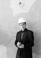 Man with hard hat, portrait, b&w