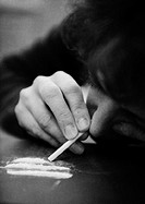 Woman taking drugs, close-up, b&w