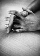 Clasped hands, close-up, b&w