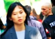 Businesswoman in crowd