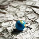 Small world globe on top of U S Dollars