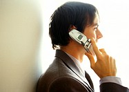 Businessman on cell phone, side view, head and shoulders