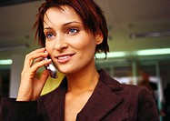 Businesswoman talking on cell phone, portrait