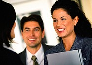 Businesspeople smiling at each other