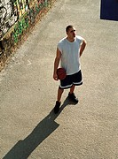 Man holding basketball, shot from above