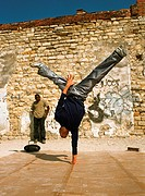 Man balancing on one hand, break dancing