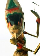 Colorful wooden marionette, close-up