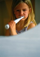 Little girl with electric toothbrush