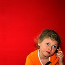 Little girl with telephone
