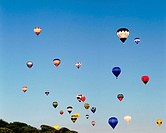 Colourful balloons in clear blue sky