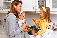 Mother and daughters in kitchen (thumbnail)