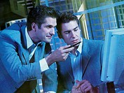 Businessmen at computer