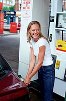 Girl at petrol station