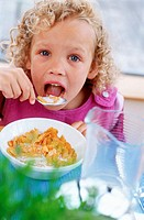 Girl eating breakfast (thumbnail)