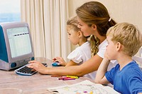 Mother and kids at computer