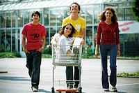 Teenagers with shopping trolley (thumbnail)