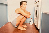 Man in front of washing machine