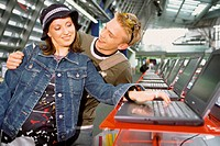 Couple in computer shop