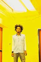 Man standing in yellow room