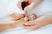 Woman receiving podiatry treatment