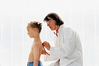 Boy being examined by doctor